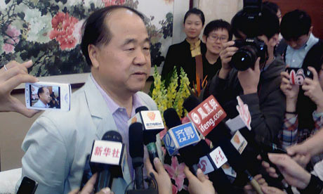 Chinese writer Mo Yan talks to the media during a news conference in Gaomi