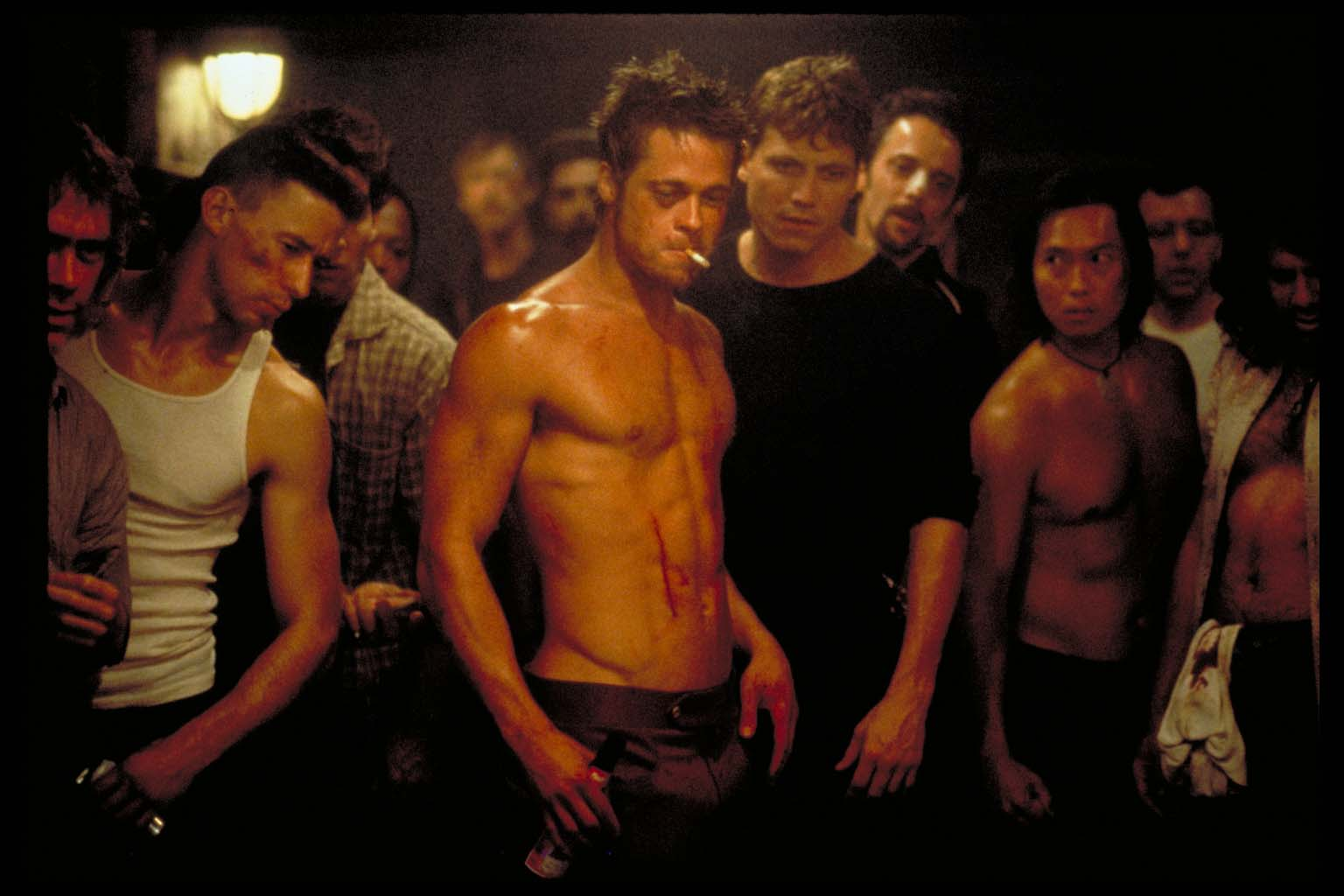"""review of fight club """"a young urban professional who works for a major car manufacturer can't sleep although he doesn't have any of the associated afflictions, he stumbles across support groups as a means to let out whatever emotions he is feeling, which in turn is allowing him to sleep but the use of these."""