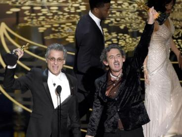 "Mark Mangini, left, and David White accept the award for best sound editing for ""Mad Max: Fury Road"".Source:AP"
